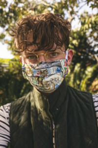 college student on campus wearing medical mask, gray vest and glasses